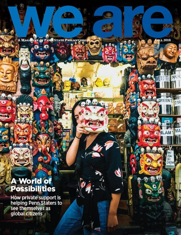 We Are magazine cover with masks in a foreign land.