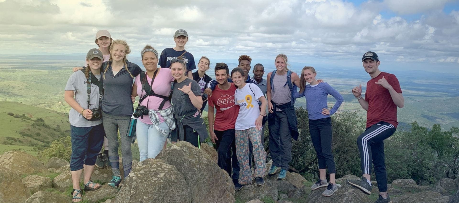 Group of Penn State students on a mountaintop in Kenya.