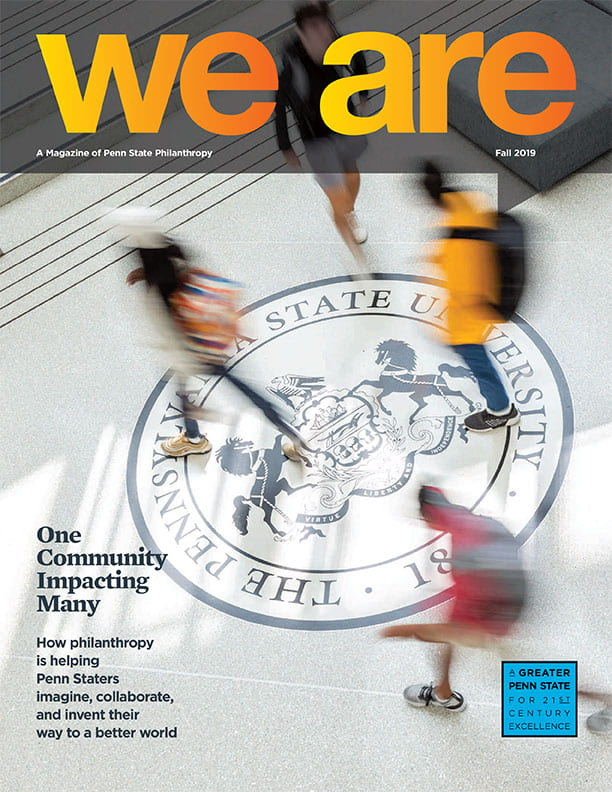 We Are magazine cover with image of blurry students walking over the University Seal in the HUB.