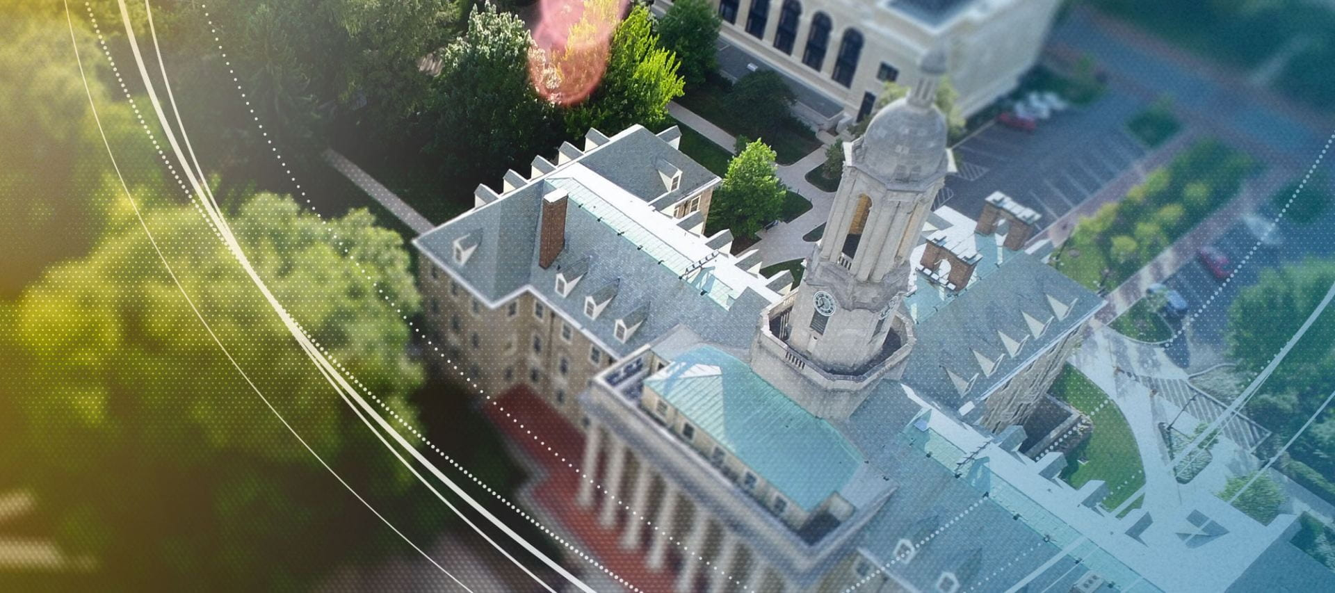 Penn State's Old Main building viewed from above via a drone.